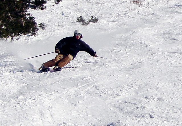 Hard carving on the DPS Wailer 99, Alta Ski Area.
