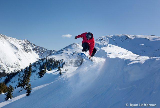 Justin Bobb launches off of Highline ridge at Taos Ski Valley.