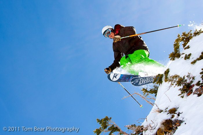 Jason Hutchins launches off a rock at Alta, wearing the Black Diamond Patrol glove.