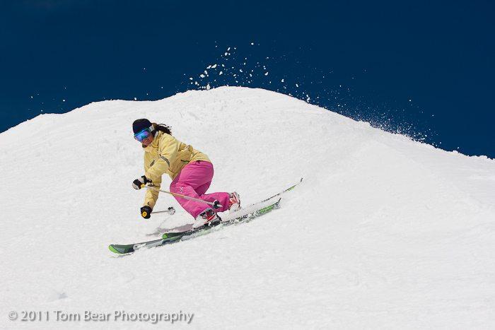 Kate Hourihan in a sweet telemark turn, Alta Ski Area.
