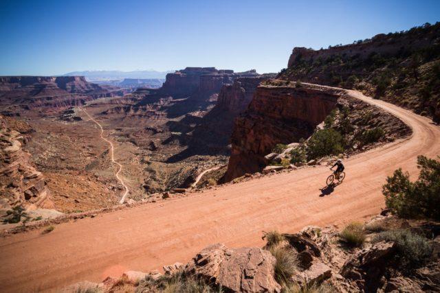 Biker on White Rim trail in Canyonlands National Park, Moab, Utah.